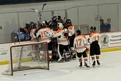Keene Boys Ice Hockey Team Celebrates