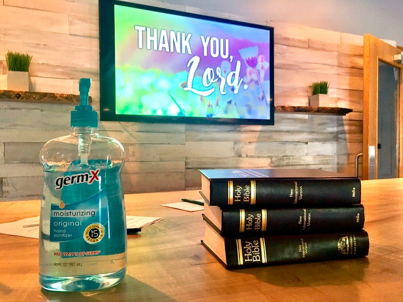 Together safely in the house of God: Congregation, distanced by virus, gathers again bibles