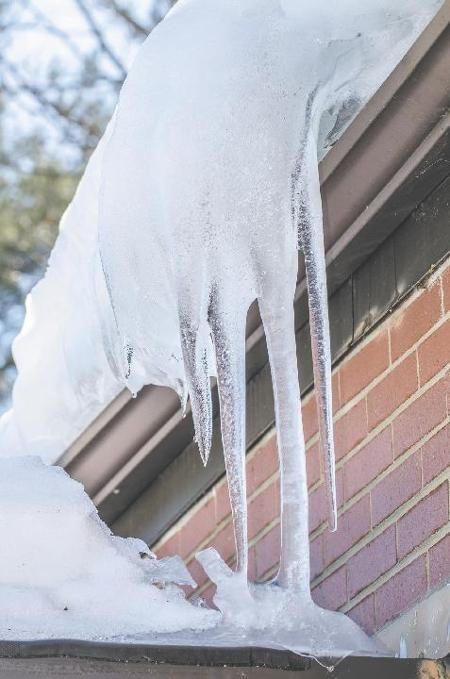 As Ice Buildup Thaws Area Roofs Begin Leaking Local