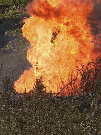 Firefighters battle blazing gas well
