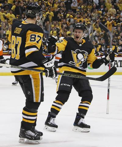 1265805395d Crosby hat trick sparks Pens over Flyers