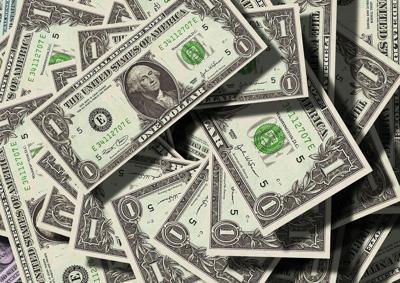pile of dollar bills money