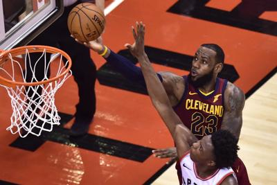 1fc36b49fcb9 Cleveland Cavaliers  forward LeBron James lays in a basket against the Raptors  during the second half of Tuesday s playoff game at the Air Canada Centre in  ...