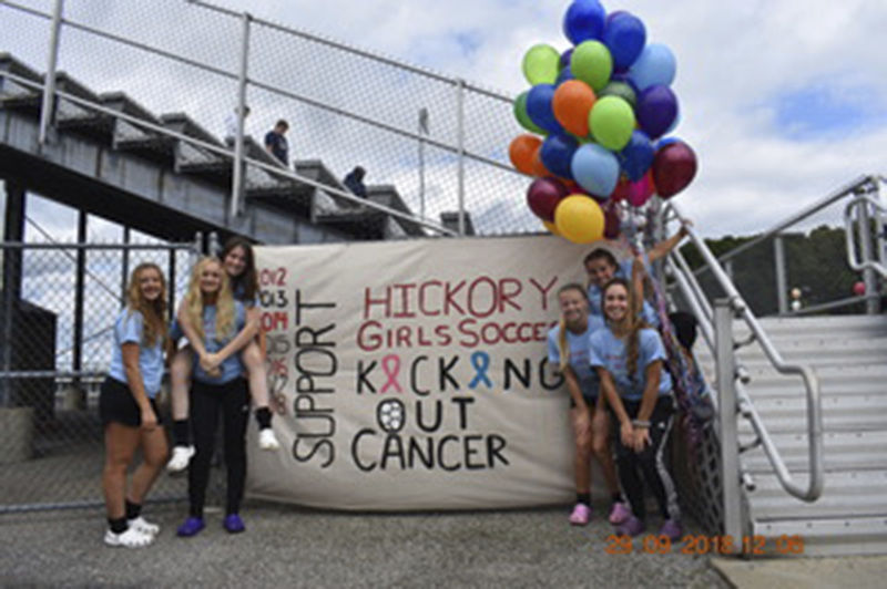 Soccer players kick out cancer