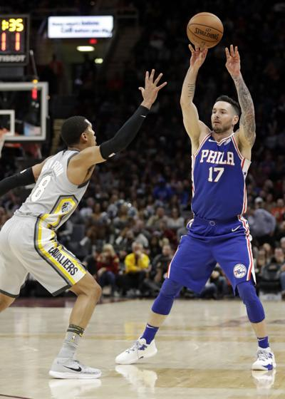 daa47c897382 Philadelphia 76ers  JJ Redick passes over the ball over the Cavaliers   Jordan Clarkson in the second half of Thursday s game in Cleveland.
