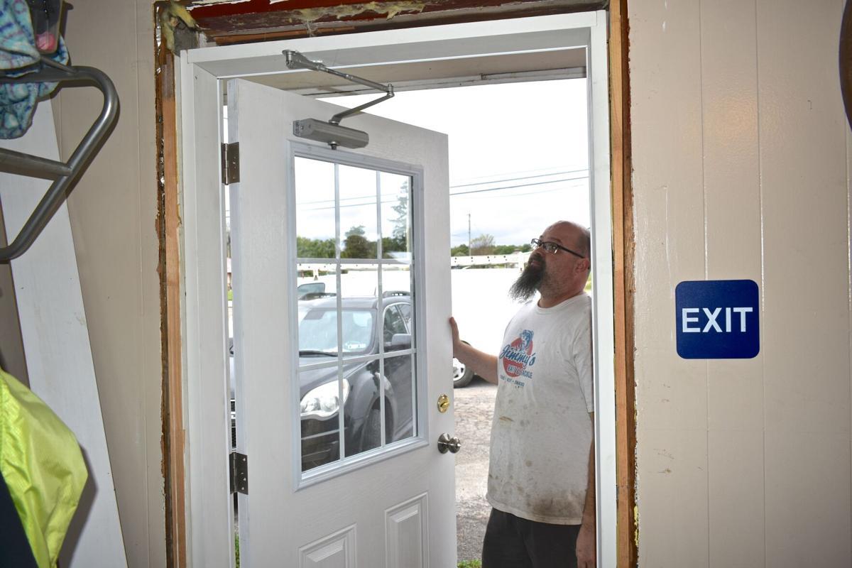 Small tornado hits Lake Township door