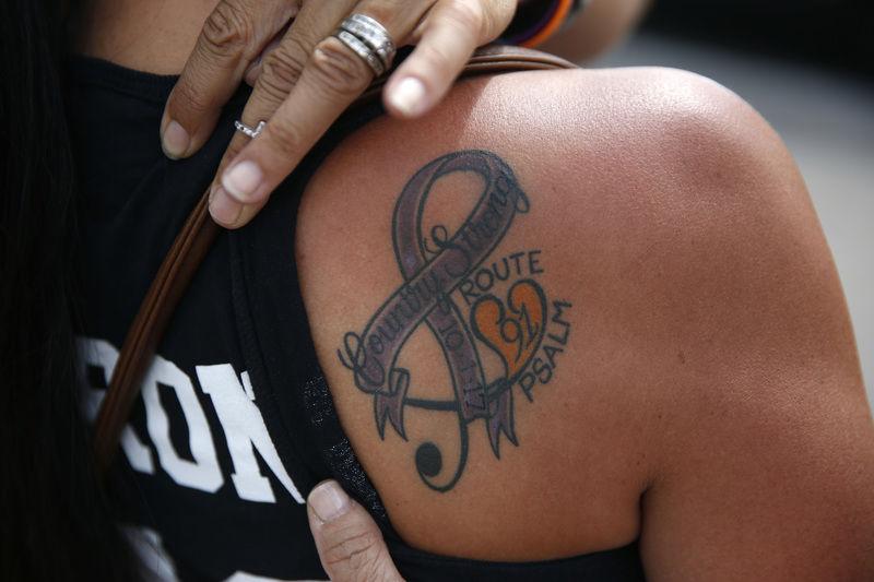 4729e5c2b Vegas shooting left 'pain that never really goes away'. APNorma Felix  displays a tattoo ...