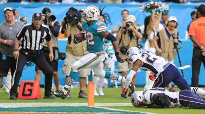 325b14297 NFL Capsules: Dolphins pull off miracle play to beat Pats | Sports ...
