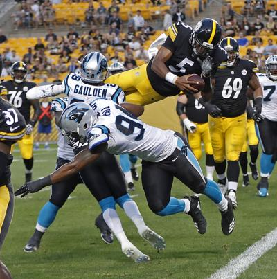 6289f2f42 APTOPIX Panthers Steelers Football. Steelers  quarterback Joshua Dobbs  leaps over Carolina ...