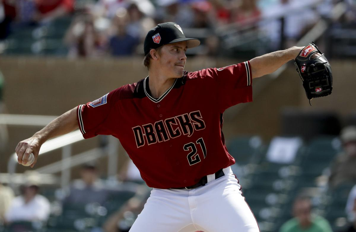 6e0c515c5c8 Arizona Diamondbacks  starting pitcher Zack Greinke is pictured throwing  against the Cincinnati Reds during a recent spring training game in  Scottsdale
