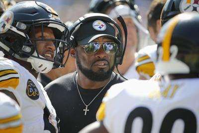 eb8c08be6 Pittsburgh Steelers  head coach Mike Tomlin talks to his players during the  second half of Sunday s game against the Bears at Soldier Field in Chicago.