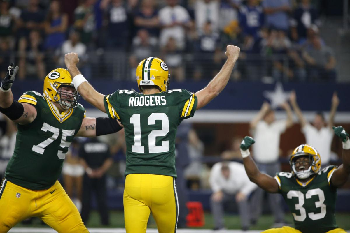 Green Bay Packers Bryan Bulaga 75 Aaron Rodgers 12 And Jones Celebrate The Game Winning Touchdown Against Dallas Cowboys On Sunday In
