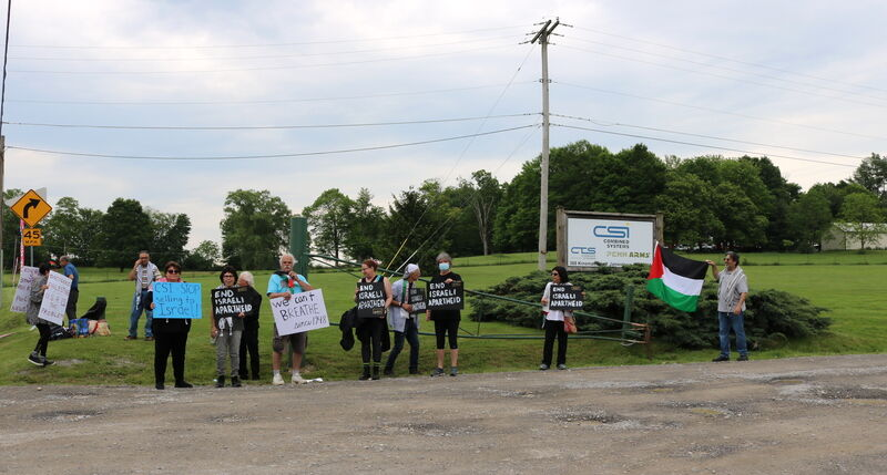 Protesters picket outside Combined Systems