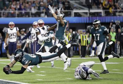 607fb39c638 Philadelphia Eagles  Zach Ertz dives into the end zone for a touchdown  against the New England Patriots during the fourth quarter of Super Bowl  LII (52) at ...