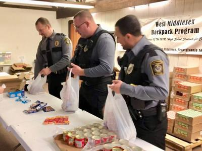 Police donate No Shave money to West Middlesex school food backpack program