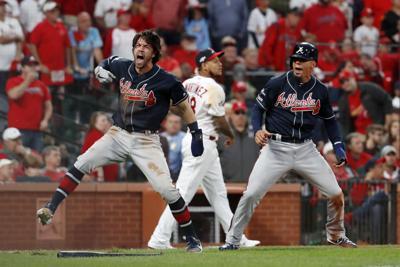 APTOPIX NLDS Braves Cardinals Baseball