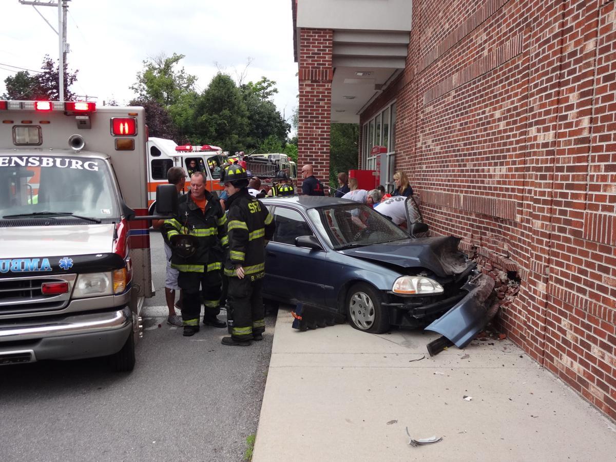 car crashes into cvs pharmacy police