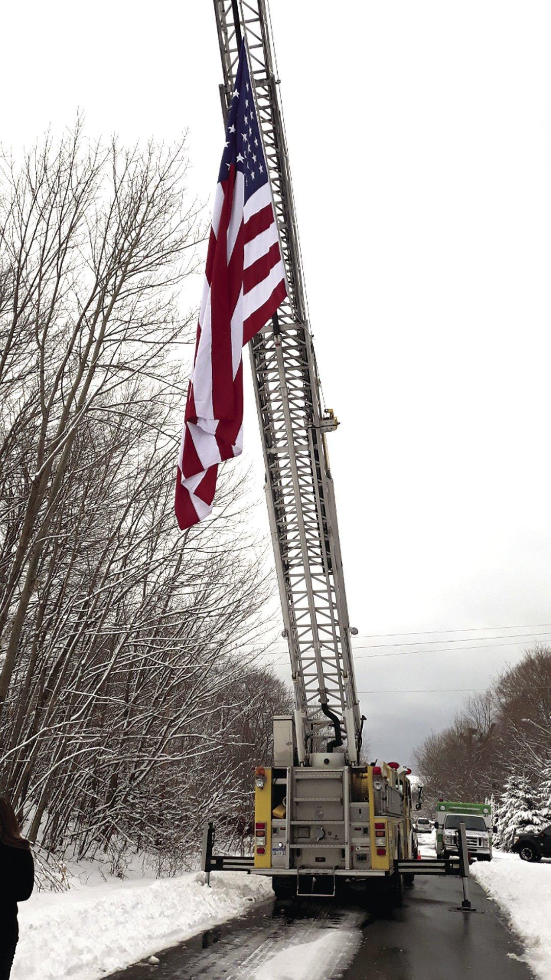 Flag lowered at HFH veteran build groundbreaking