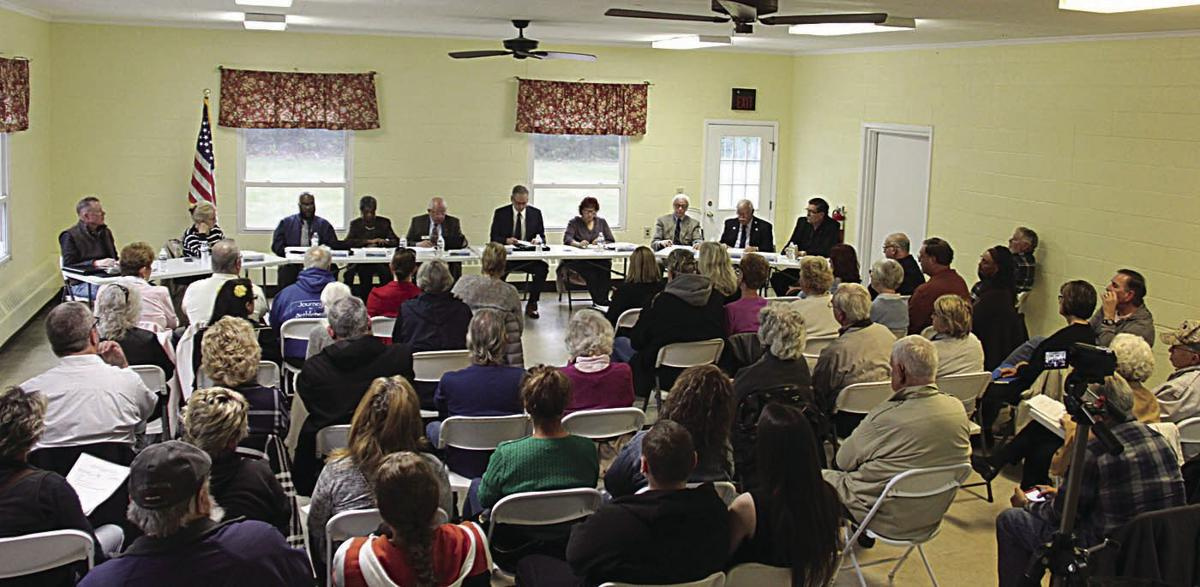 Full house remains silent at county commissioners meeting