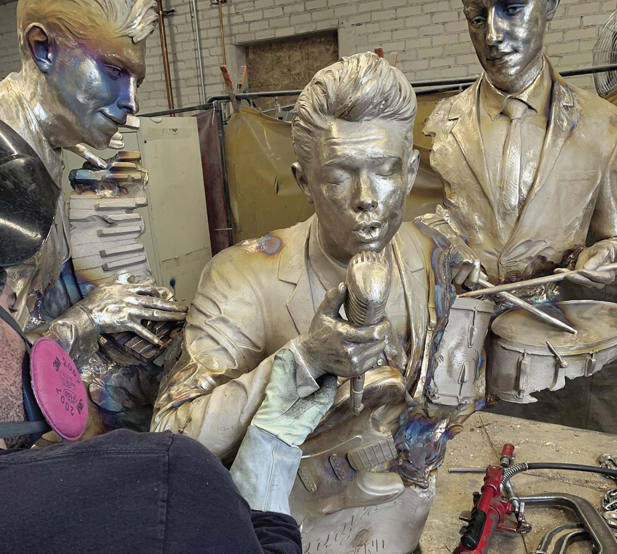 Artist works on Johnny's Bandstand sculpture