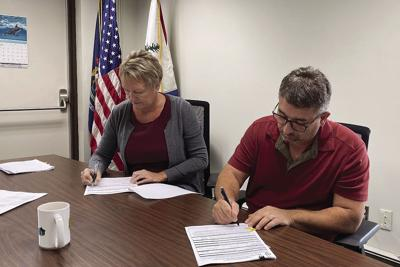 P.M. Township signing on Parcel 5