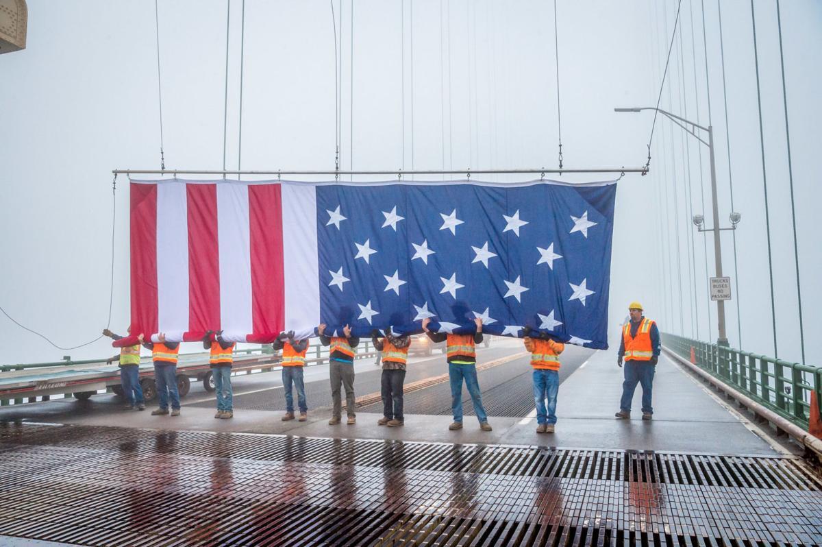 MBA workers hanging flag Memorial Day 2017.jpg