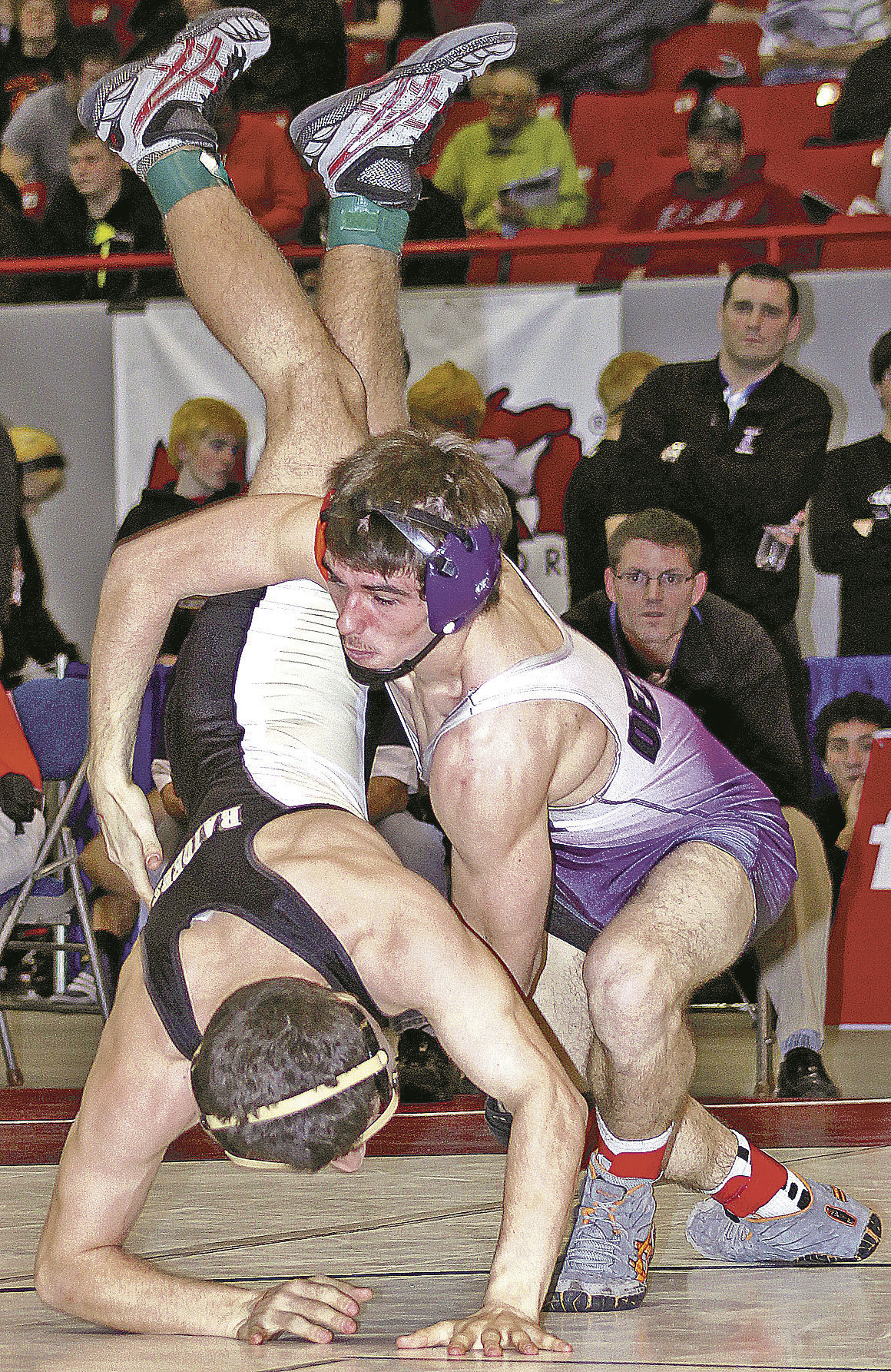 sp.p-s. shelby wrest Trevor Dezwaan works a takedown vs Decatur in quarter finals.jpg
