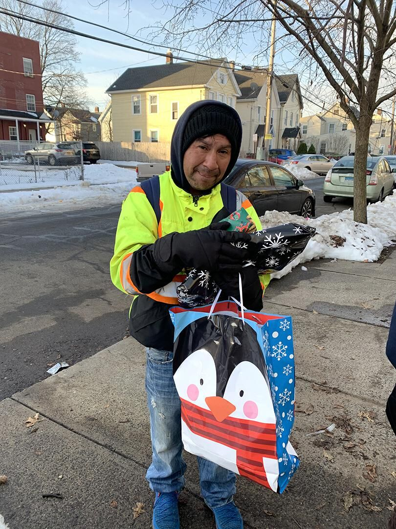 Branford Catholic students, faculty, offer Christmas donation to New Haven worker house