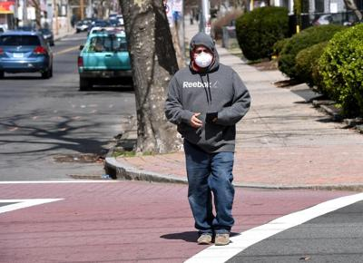 Officials: COVID masks don't belong on your chin or car mirror