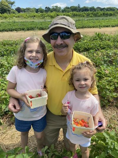 Taking the grandkids to pick strawberries and share a laugh