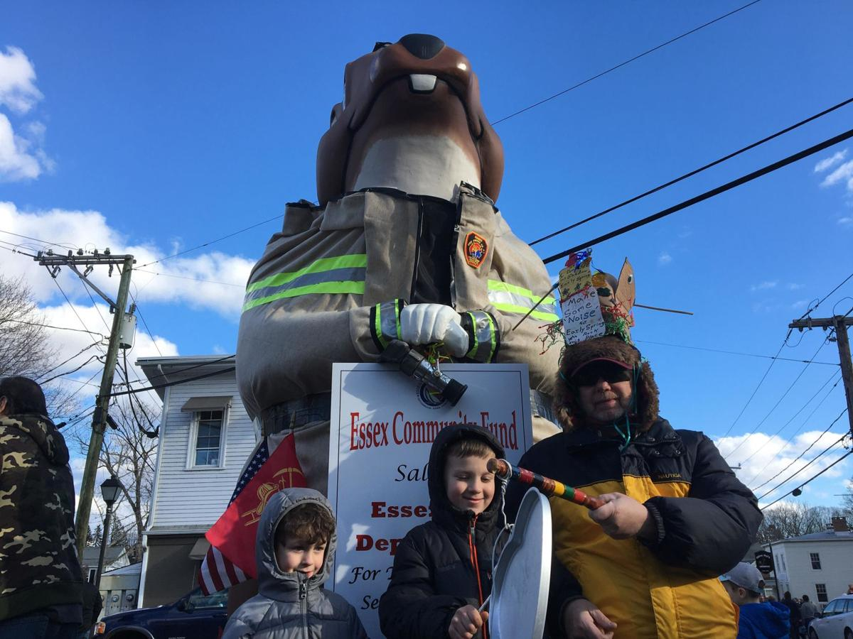 A few hundred hearty, clanging souls line Main Street for annual Essex Ed Groundhog Day Parade