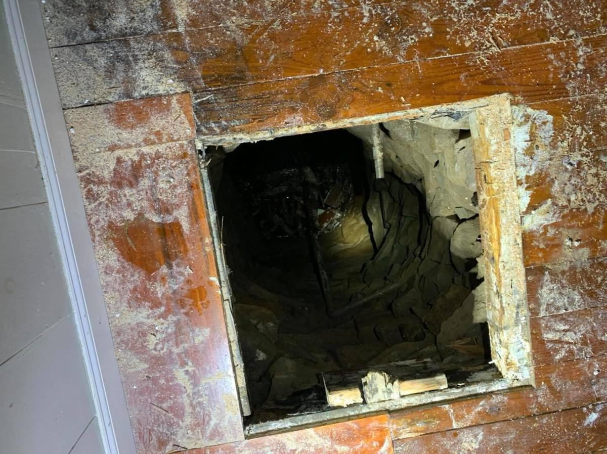 Firefighters rescue man who fell into well beneath Guilford home