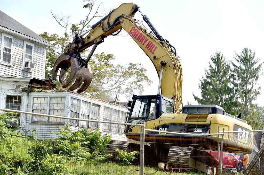 PHOTOS/STORY: 'It is detective work.'Madison General's Residence taken down piece by piece