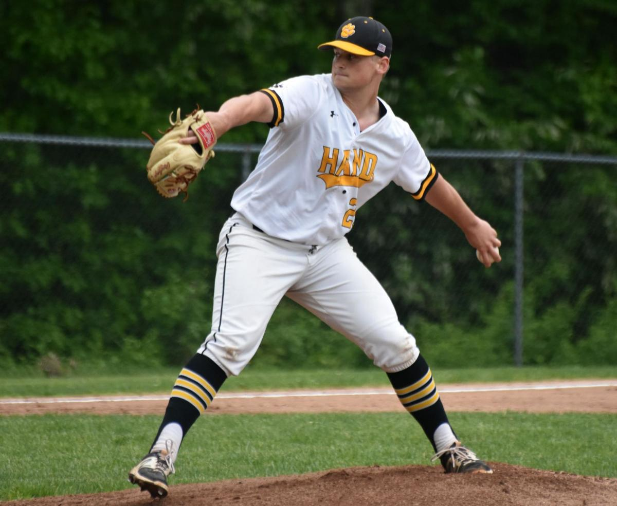 Four-run sixth lifts Hand past rival Guilford