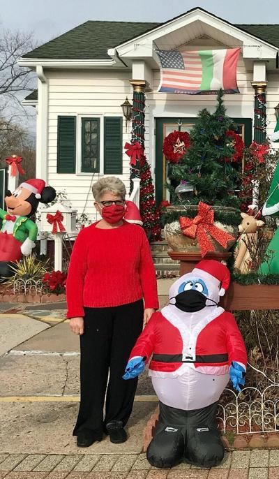 Masked Santa ready for the holidays at beloved display at Lucy's Tailor