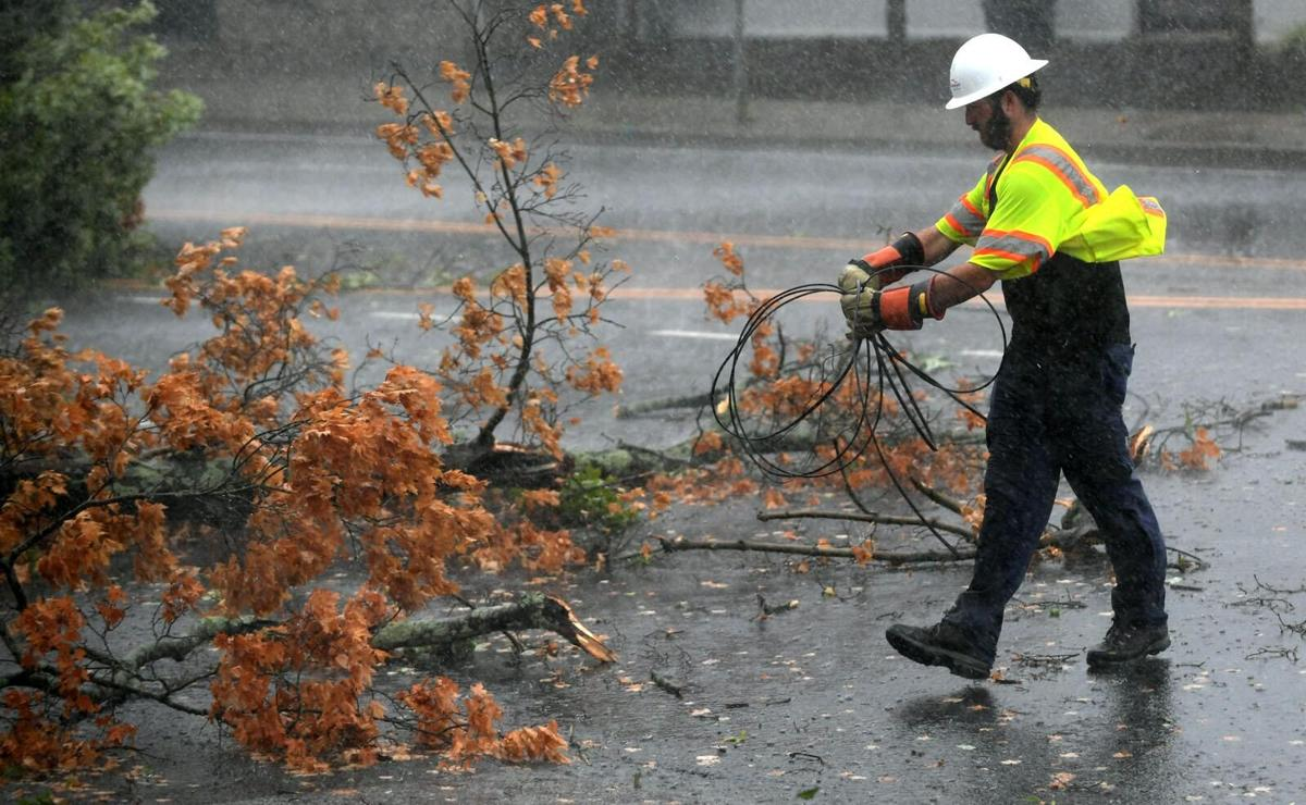 Hundreds of thousands lose power as Isaias' winds topple trees, wires