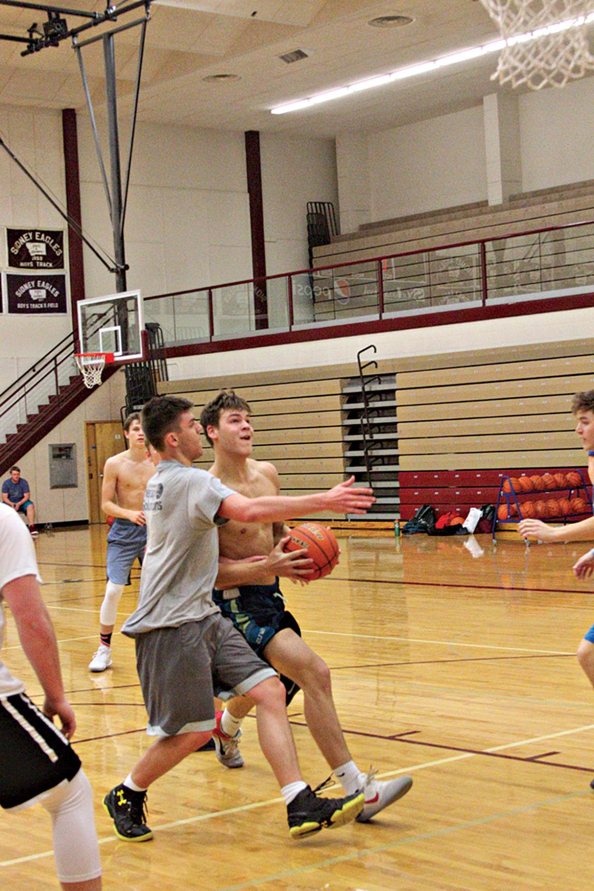 Eagles feature good size to open boys basketball season