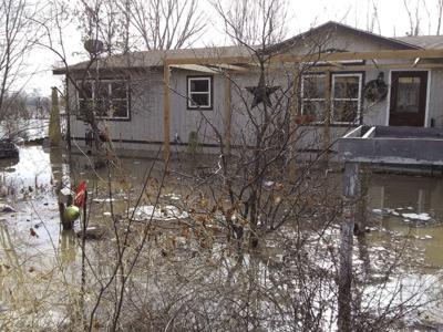 190407-news-floodedhouse cmyk.jpg