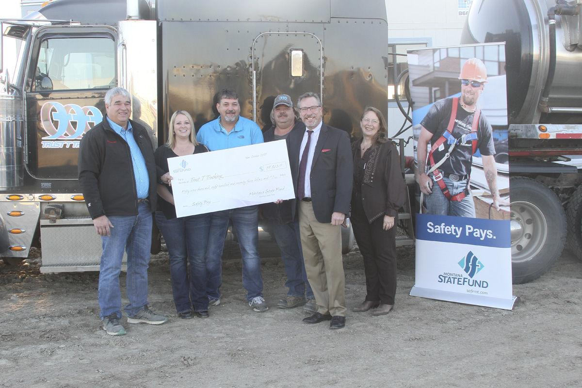 Montana state fund presents check to trust t trucking