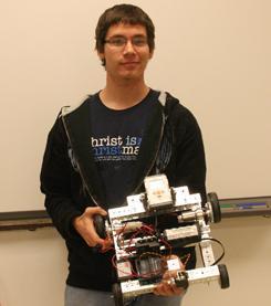 Computer savy student helping his school