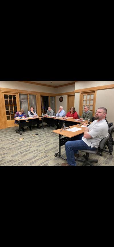 School board meeting football coaches