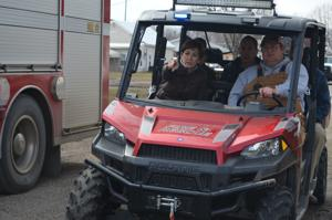Kim Reynolds tours Hornick as town recovers from flood