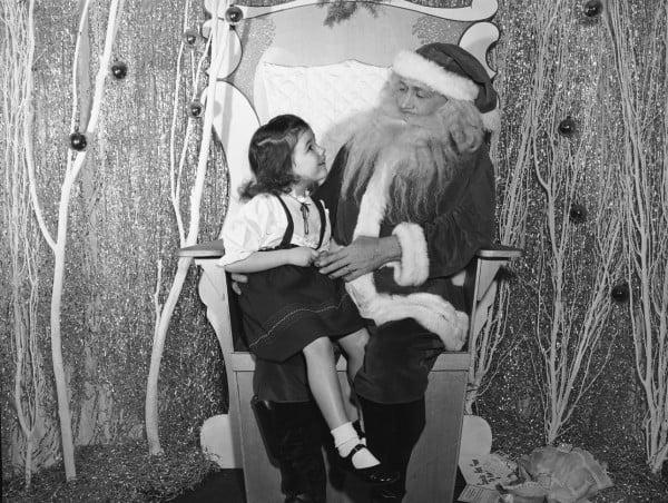 Santa visits with children at Younker-Davidson store