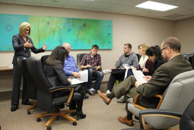 siouxland business leaders students tackle federal budget in mock
