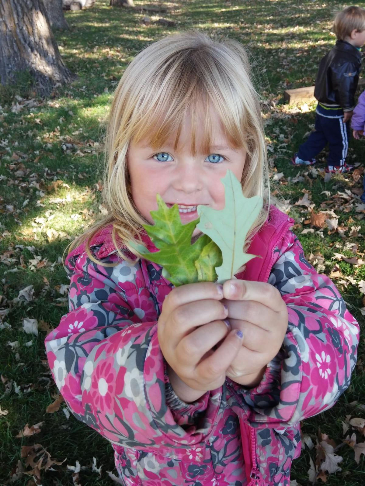 Child holding leaves