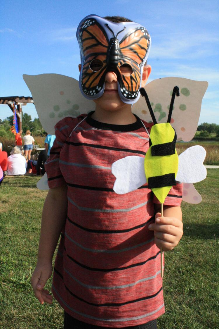 Kid dressed up with bee and butterfly