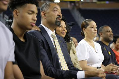 Juwan Howard sits with his wife Jenine  as he waits to be introduced by University of Michigan Athletic Director Warde Manual as the new head basketball coach during a press conference on Thursday, May 30, 2019 at Crisler Center in Ann Arbor, Mich.