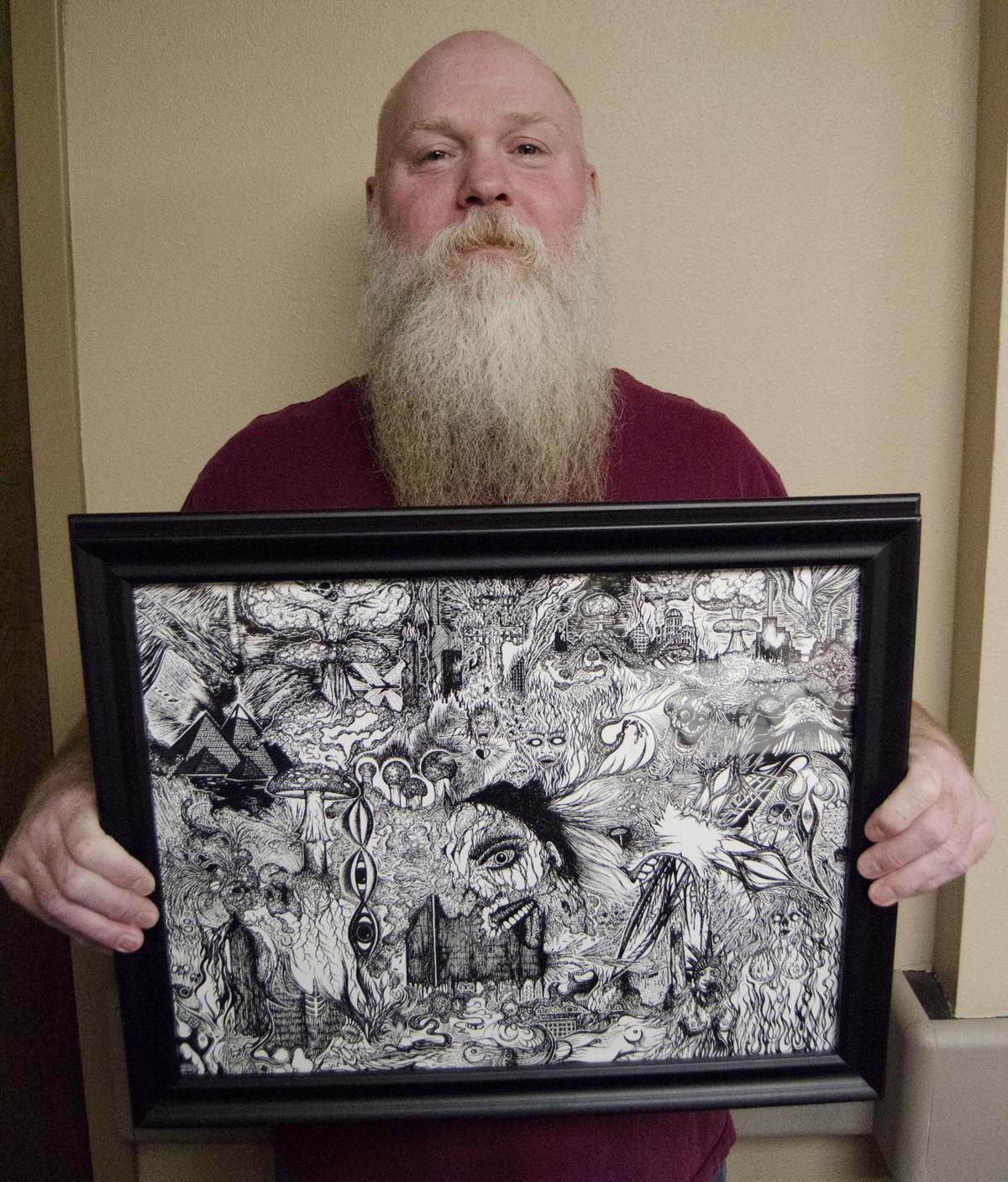 Eric Hovde holding art