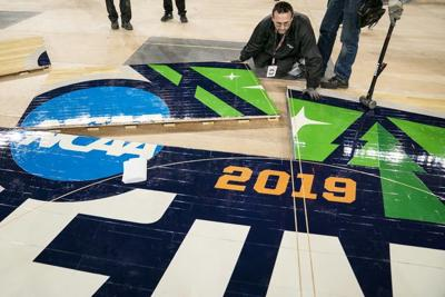 SMG operations worker Michael Stauffacher helped install the official 2019 NCAA Final Four basketball court Friday at U.S. Bank Stadium.