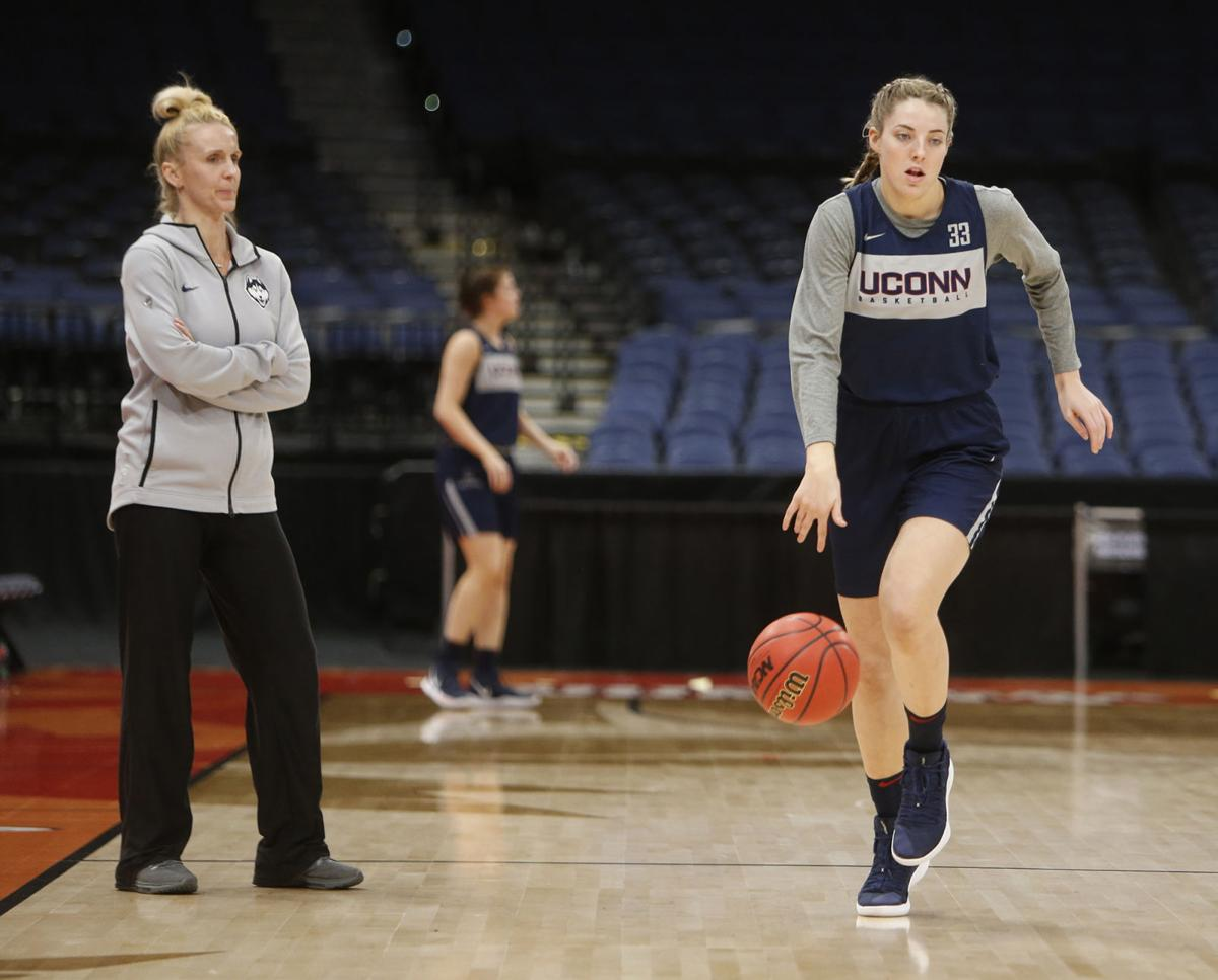 Connecticut's Katie Lou Samuelson, right, runs offensive drills in practice ahead of the NCAA Tournament's Final Four at the Amalie Arena in Tampa, Fla., on Thursday, April 4, 2019.